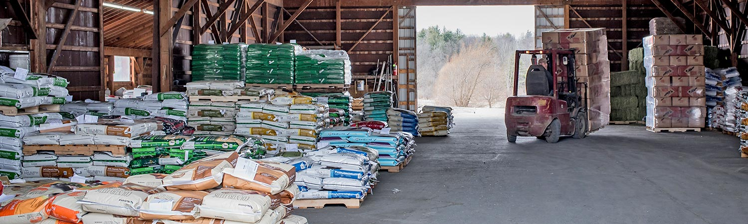 Walker's Farm feed pallets and skid loader
