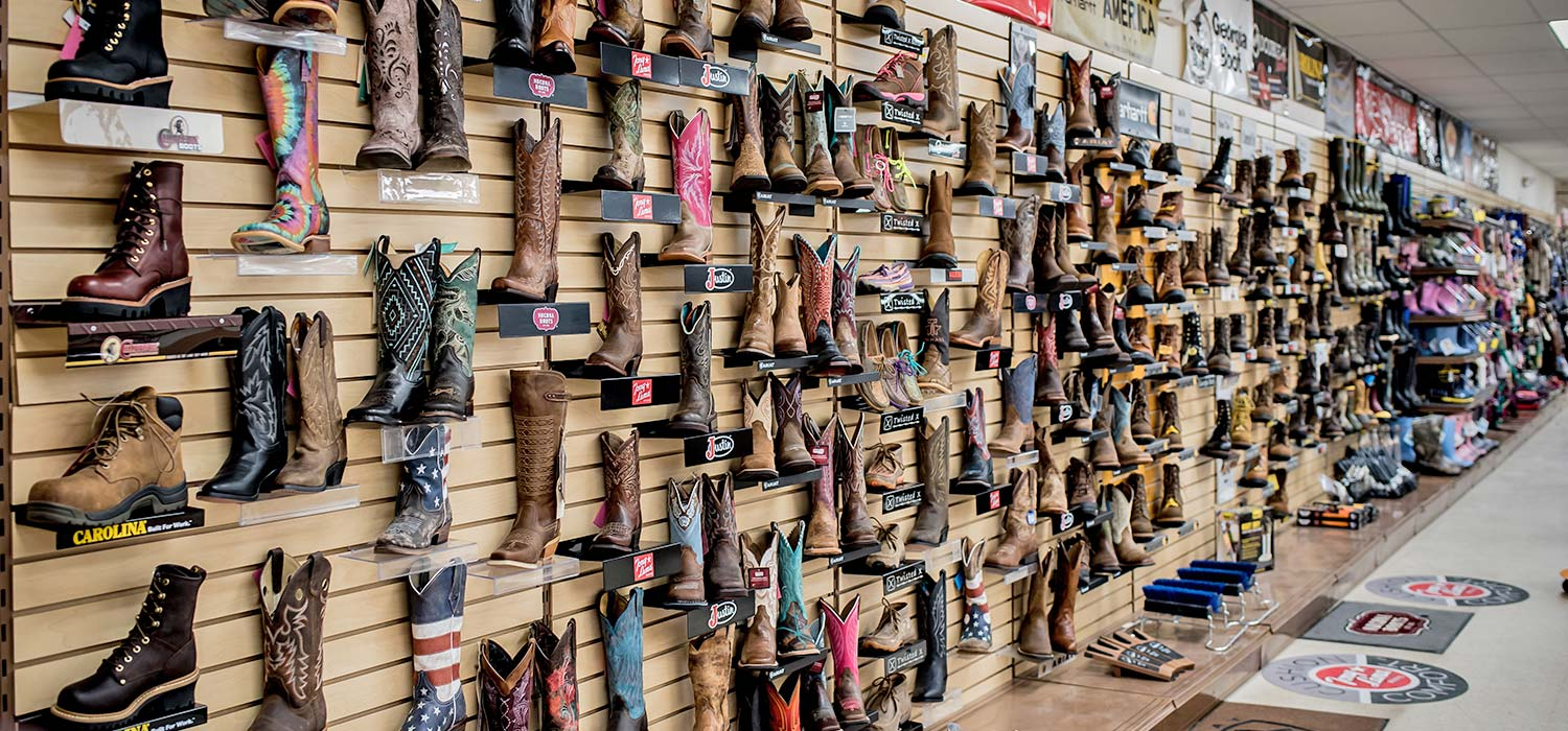 Boots for sale on display on wall